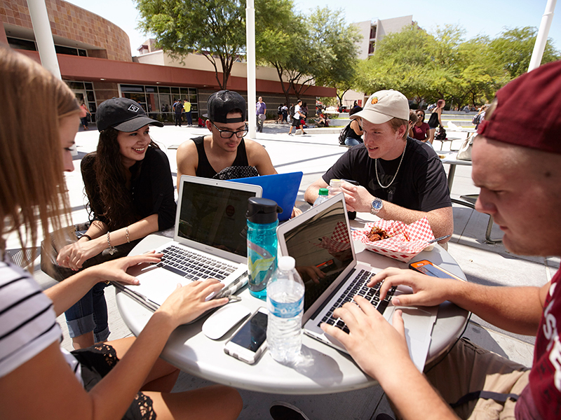 """alt=""""A group of students sitting down at a table"""""""