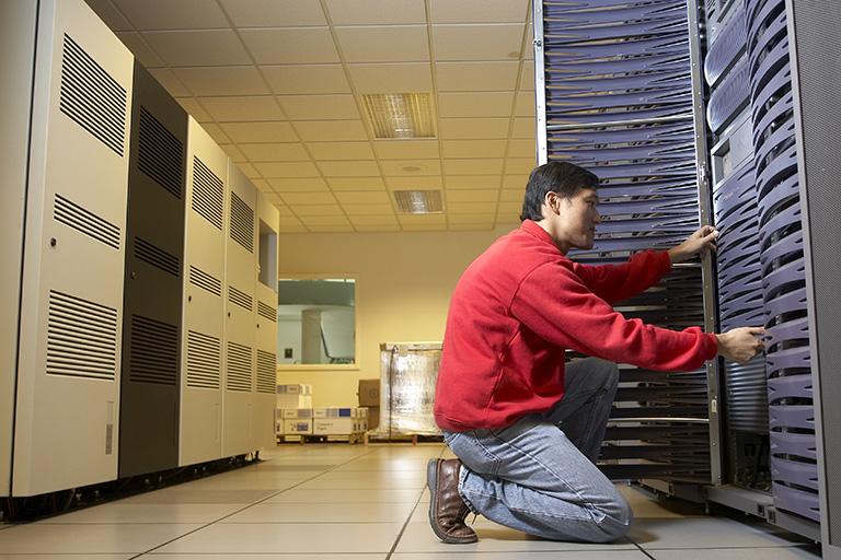 Man working inside of a server room