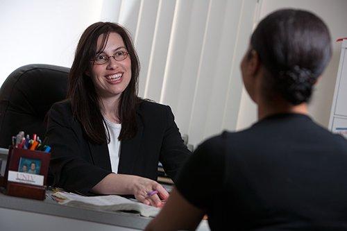 Academic advisor talks with a student.