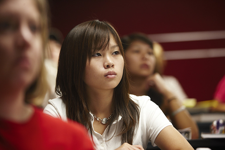 Student paying attention in class.