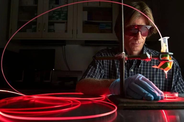 A man conducting an experiment
