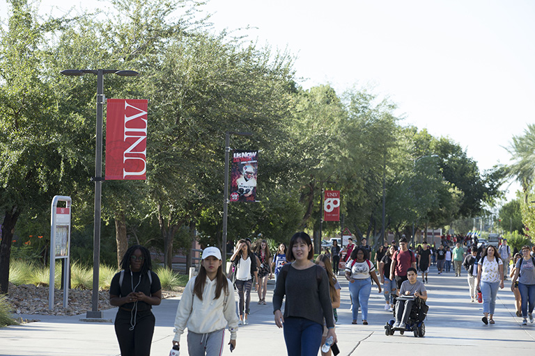 students walking along campus grounds