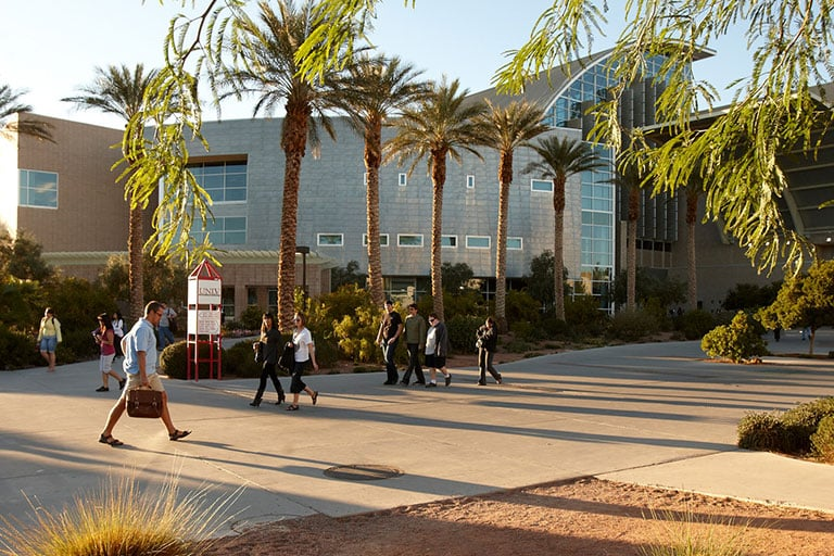 Students walking in front of the Lied Library.