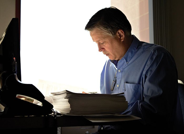 A man sitting down at a desk