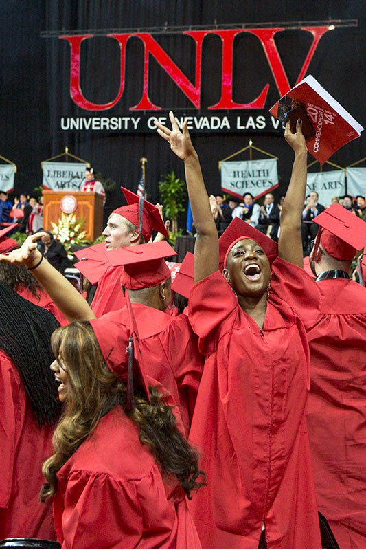 Excited graduates cheer at Commencement.