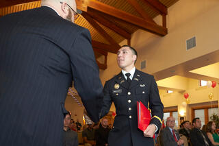 Two UNLV veterans shaking hands