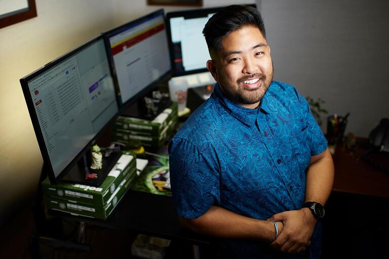 Portrait of Grant Kurosu, web communications specialistin office.