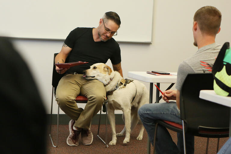 man in meeting with dog