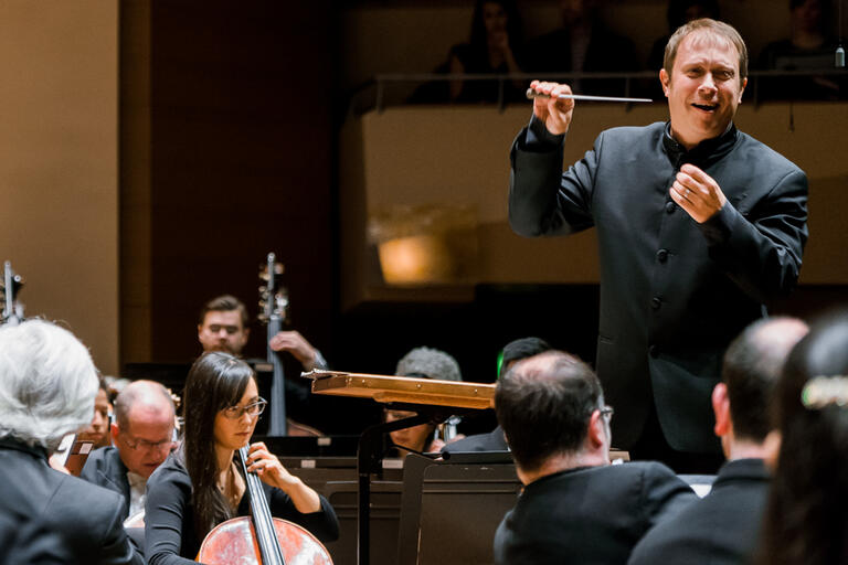conductor in front of symphony