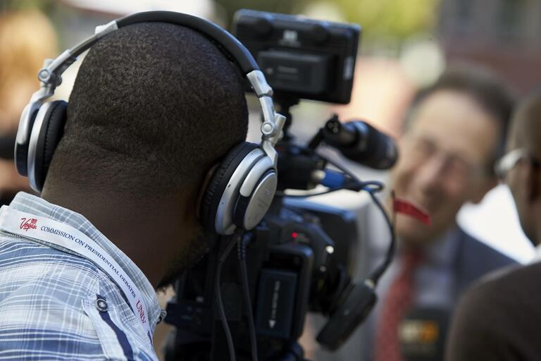 A man being interviewed by a videographer.