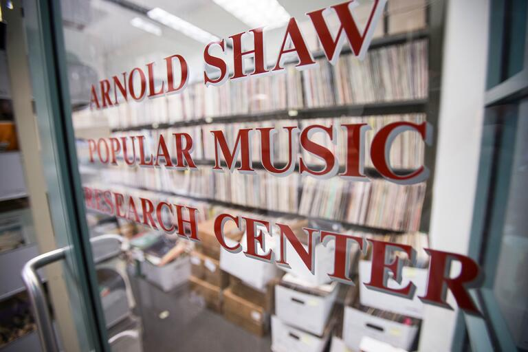 center entrance with shelves of vinyl records inside