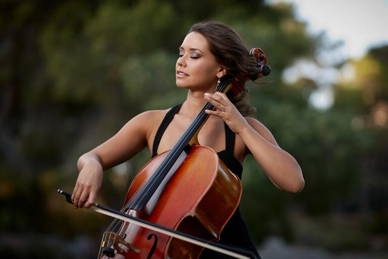 Student play cello with eyes closed.